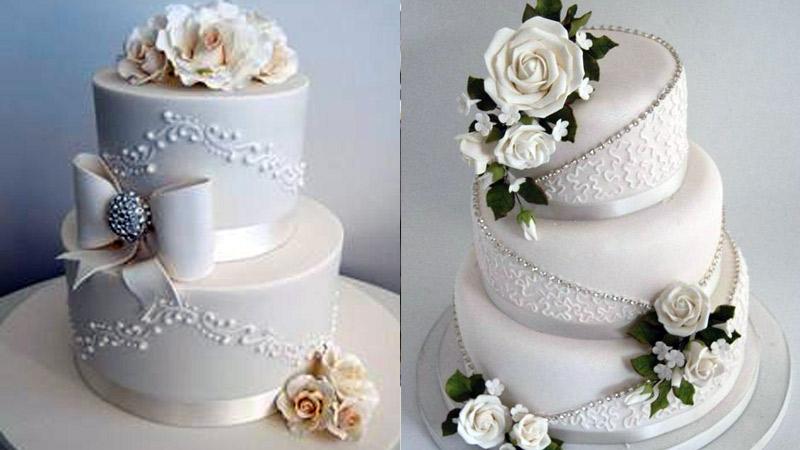 Tortas clásicas en blanco y flores decorativas
